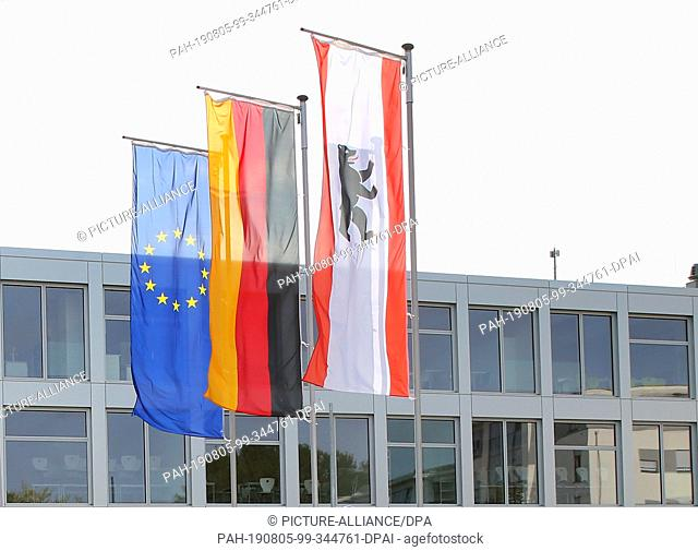 05 August 2019, Berlin: The flags of the European Union (EU), the Federal Republic of Germany and the City of Berlin will fly during the opening of the...