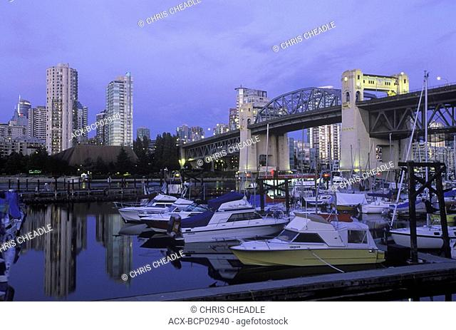 entrance of False Creek and West End condos with Burrard Bridge and marina, Vancouver, British Columbia, Canada