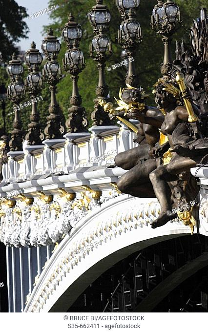Sculptures and ornate lamp posts decorated Pont Alexandre III. Paris. France