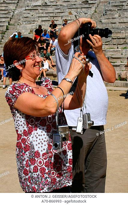 Tourists taking pictures with their digital cameras. Sanctuary of Asklepios at Epidaurus, Greece