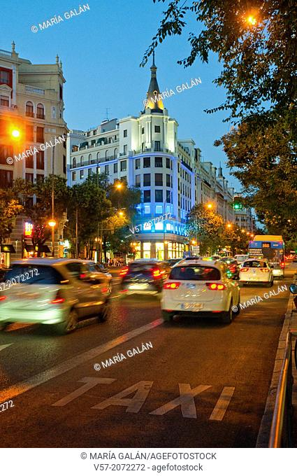 Traffic in Alcala street, night view. Madrid, Spain