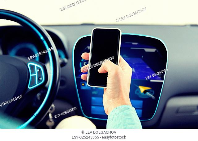 transport, business trip, technology and people concept - close up of male hand with smartphone and navigator on board computer driving car