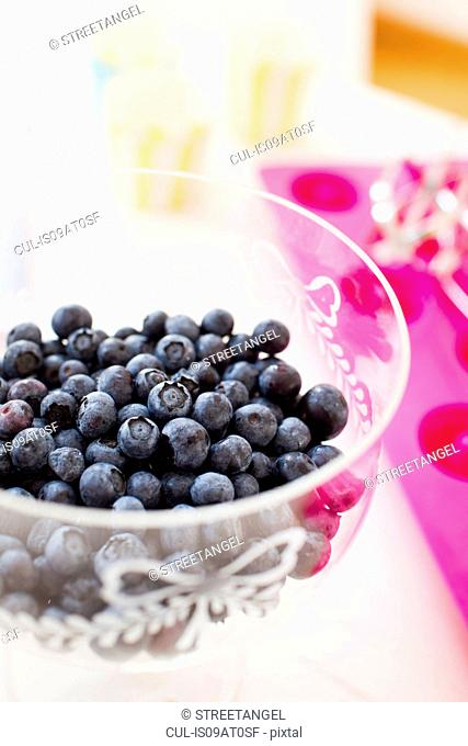 High angle view of glassed bowl of blueberries