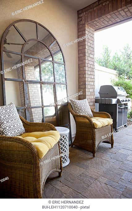View of sitting area with barbecue at patio; San Marcos; California; USA