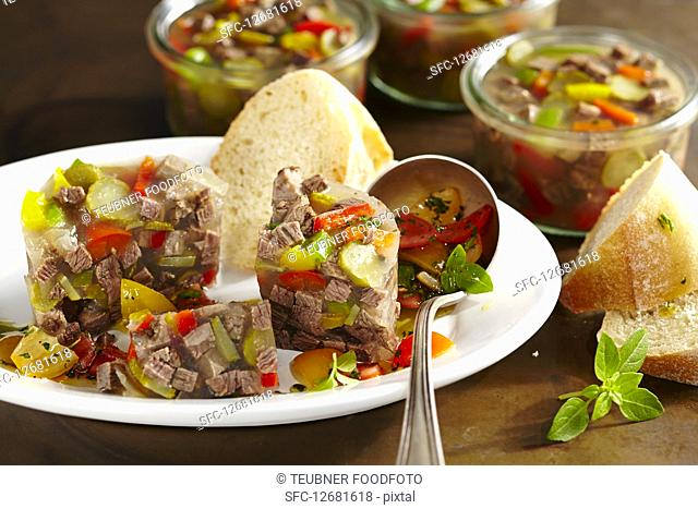 Roast beef stock with cherry tomato vinaigrette and white bread