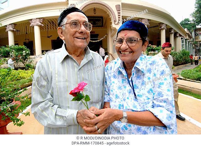 Old couple celebrating Parsi New Year Mumbai Maharashtra India, Asia, MR#736Q, MR#736R