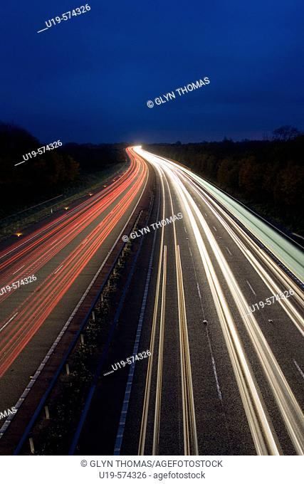 Traffic trails on the M40 motorway in Warwickshire, England, UK