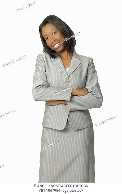Attractive woman, wearing a suit, smiling with arms crossed