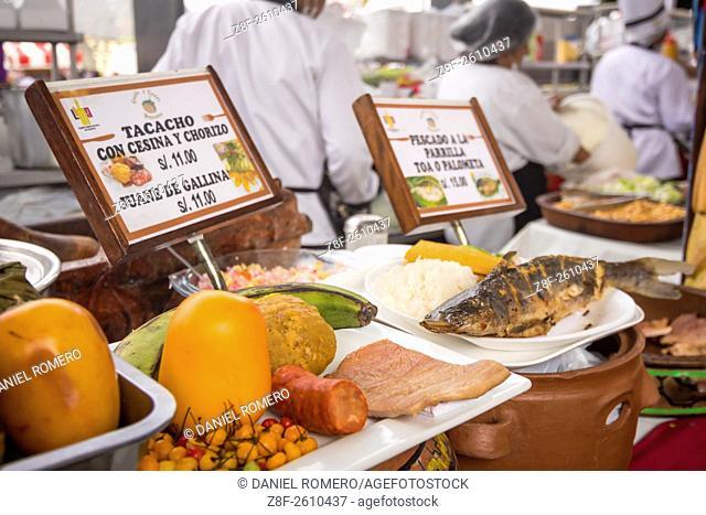 """Peruvian food dishes: """"""""Tacacho con cesina y chirizo"""""""", """"""""Pescado a la Parrilla"""""""". Peruvian seasoning and flavor, food fair"""