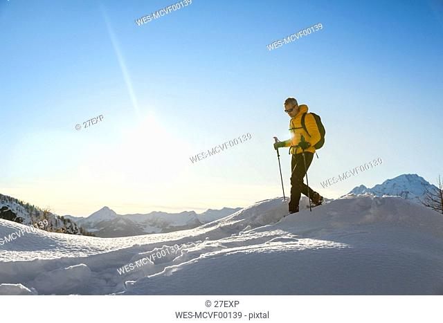 Hiking with snowshoes in the mountains, Valmalenco, Sondrio, Italy