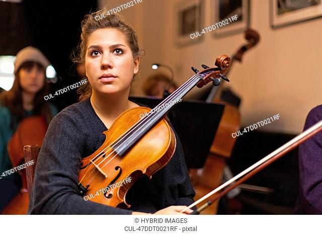 Violin player sitting in practice