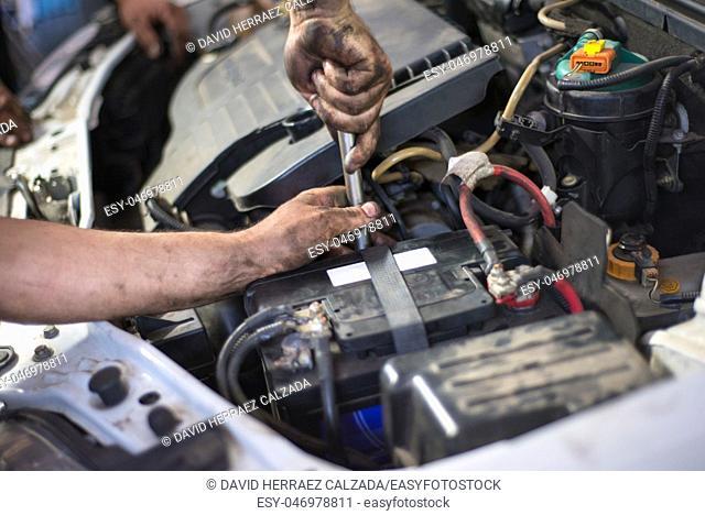 Auto mechanic repairing car. Selective focus. Car repair service