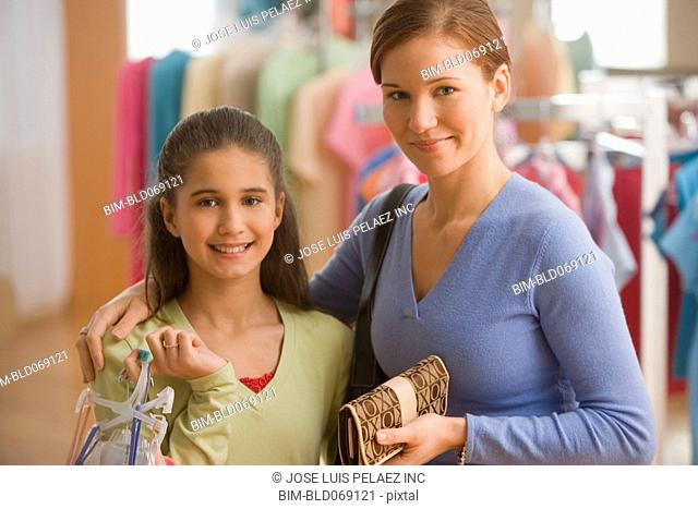 Mother and daughter at clothing store