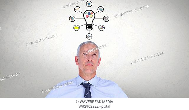 Digital composite image of businessman with light bulb graphics