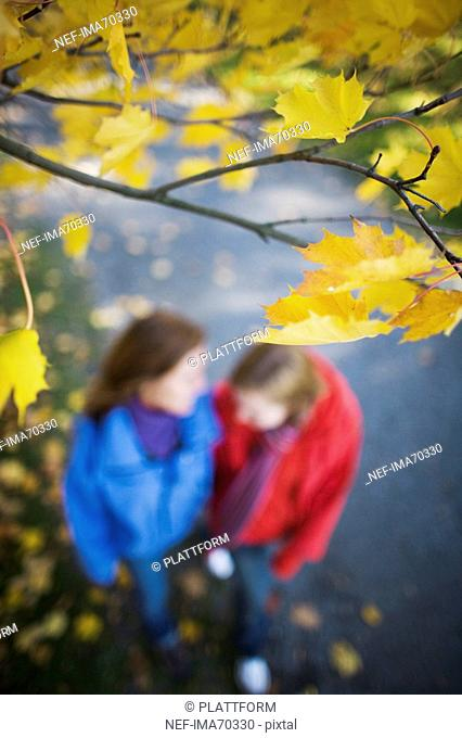 Mother and daughter outdoors walking in autumn Stockholm Sweden