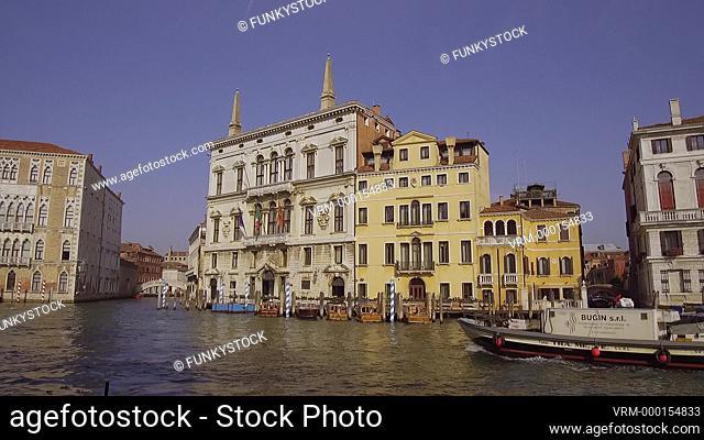 Palazzo Papadopoli with boats on the Grand Canal, Venice, Italy