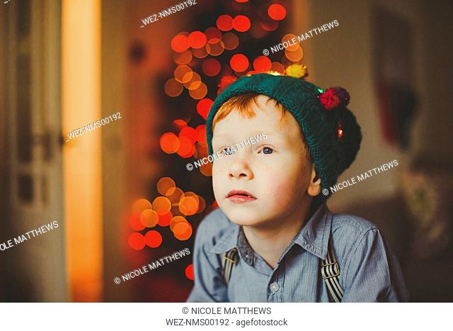 Portrait of boy wearing wooly hat at Christmas