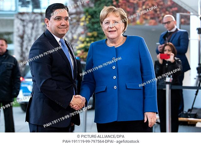 """19 November 2019, Berlin: Federal Chancellor Angela Merkel (CDU) welcomes Nasser Bourita, Foreign Minister of Morocco, to the conference """"""""Compact with Africa""""""""..."""