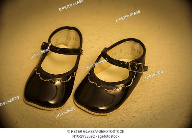 Pair of patent leather doll's shoes