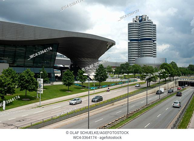 Munich, Bavaria, Germany, Europe - BMW tower 'Four-cylinder' with the BMW World showroom building along Mittlerer Ring street in Milbertshofen