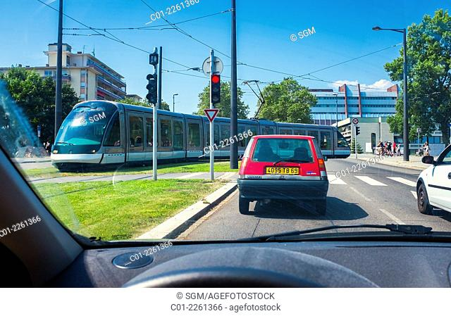 Driver view of cars traffic and tram Strasbourg Alsace France