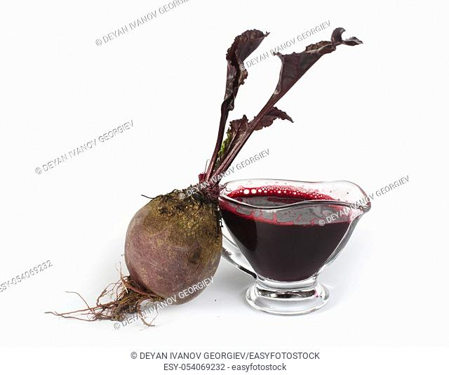 Red beets with leaves and jug with juice white isolated