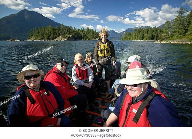 A full zodiak transports guests back to the MV Columbia III, after a day of exploring small islets within Desolation Sound