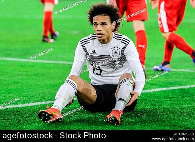 Wolfsburg, Germany, March 20, 2019: German footballer Leroy Sané on ground after a foul during the international soccer game Germany vs Serbia in Wolfsburg