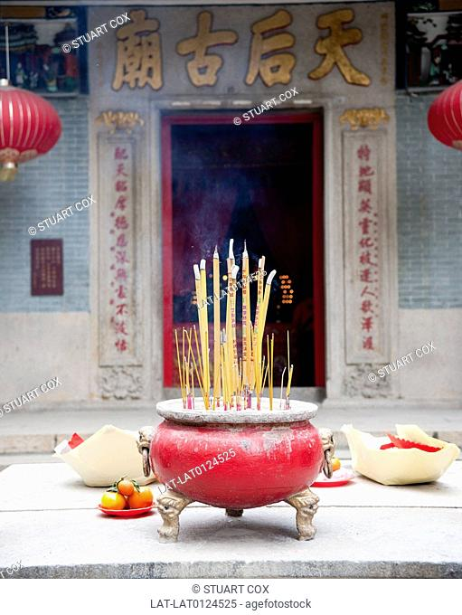 Tin Hau Temple is a traditional Buddhist temple,with large incense burners or urns containing joss sticks in the courtyard
