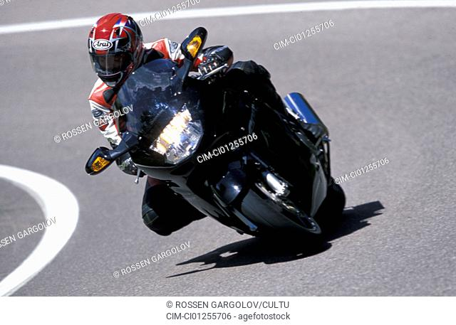 Sports motor cycle, Sporttourer, Honda CBR 1100 XX Super Blackbird, black, model year 2003, driving, inclined position, Side position, from the front