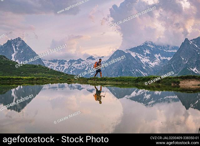 Young male hiking through at the French Alps, Chamonix, France