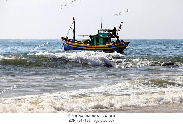 Lonely boat at ocean. Sri Lanka