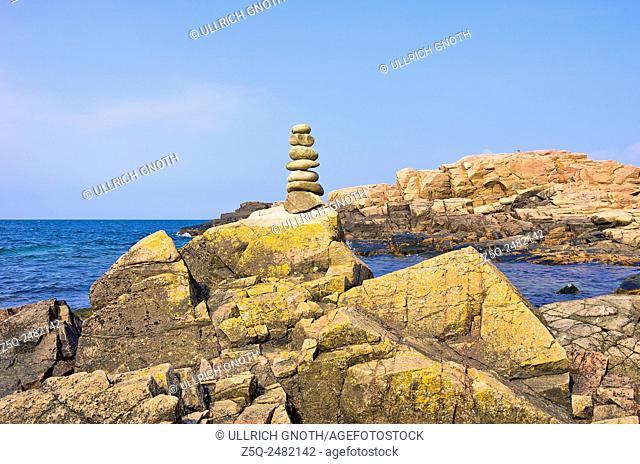Balancing pebbles, rocky coast and Baltic Sea at Hovs Hallar, Sweden