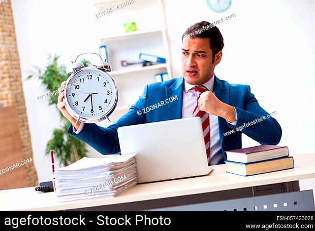 Young employee working in the office