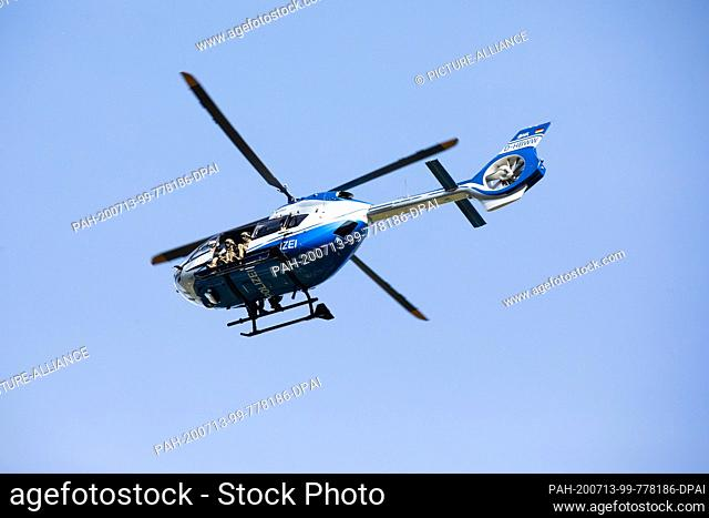 13 July 2020, Baden-Wuerttemberg, Oppenau: A police helicopter takes off from a sports field near Oppenau, which serves as a meeting point for the police