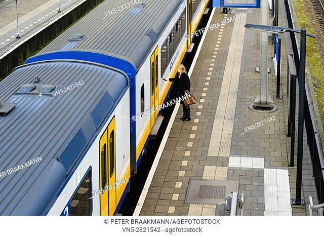 """LAGE ZWALUWE, THE NETHERLANDS â. """" JANUARY 29: Passenger train rides inside station to let passengers in and out on January 29, 2017"""