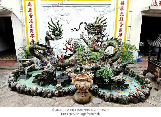 Artificial pond with a dragon figure in a Chinese temple, Hoi An, Quang Nam, Central Vietnam, Vietnam, Southeast Asia, Asia