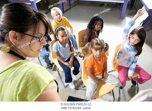 Teacher in classroom teaching young children