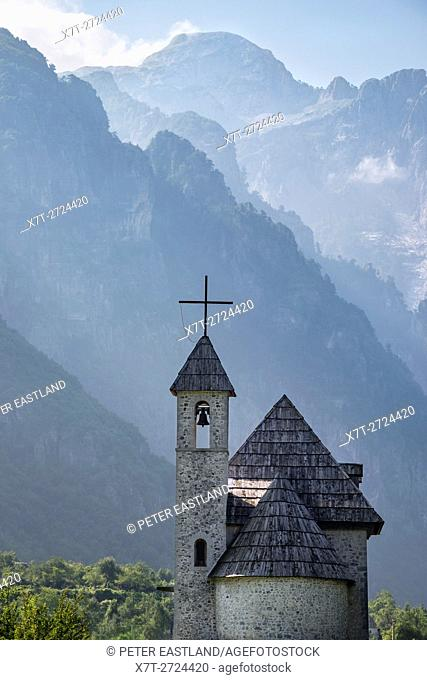 The shingle roofed church at the village of Theth With the Albanian Alps in the background, Northern Albania