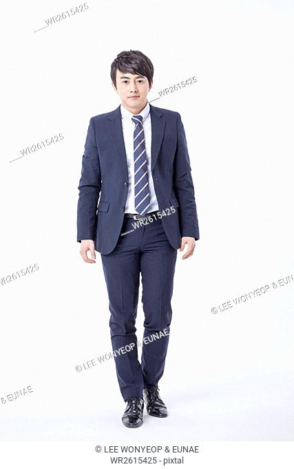 Young businessman in suit walking