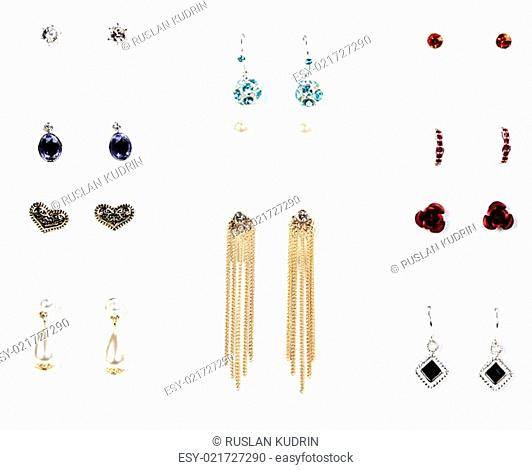 several pairs of earrings with stones