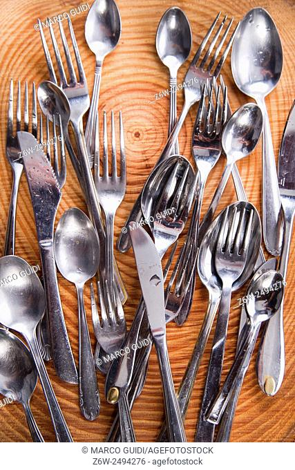 Series of steel cutlery presented above-border pine