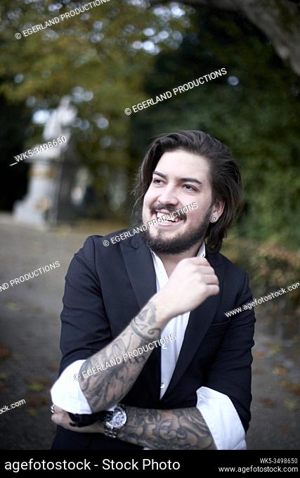 laughing man with inked arms