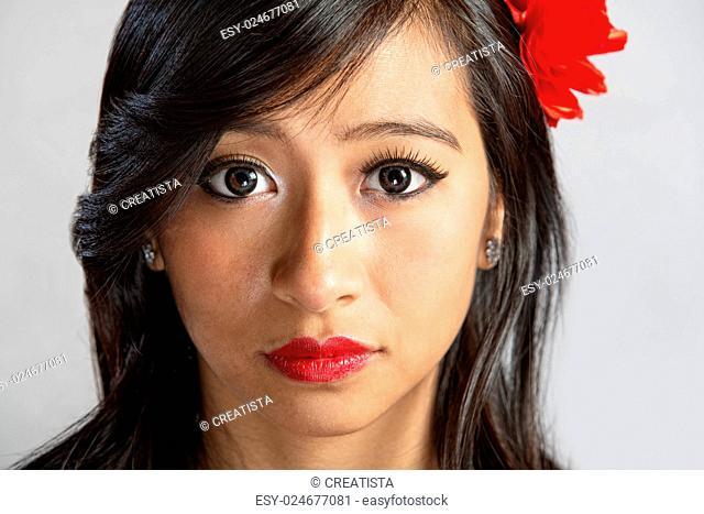 Close up of serious beautiful Hispanic female