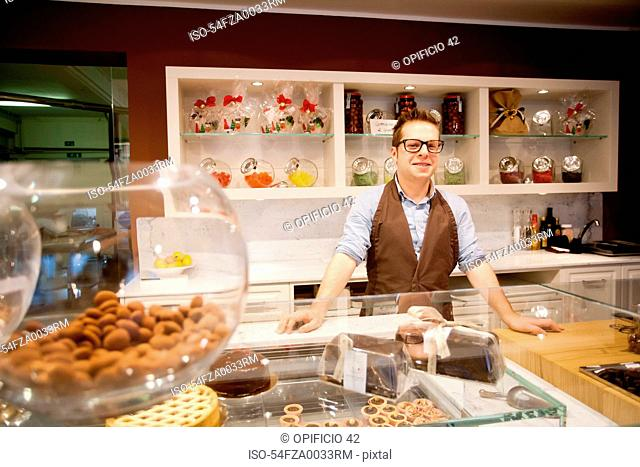 Cashier smiling behind bakery counter