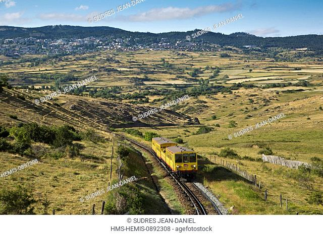 France, Pyrenees Orientales, area of Ceret, near Saillagouse, through the pastures of the Cerdan plateau at Col Rigat the Yellow Train of Cerdanya called the...
