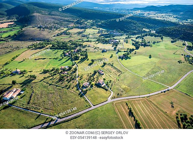 Birds eye view of the cultivated land, roads and private houses of Provence