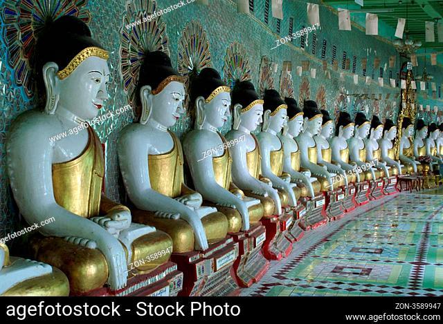 Buddhas and wall, Sagaing hill, Mandalay, Myanmar