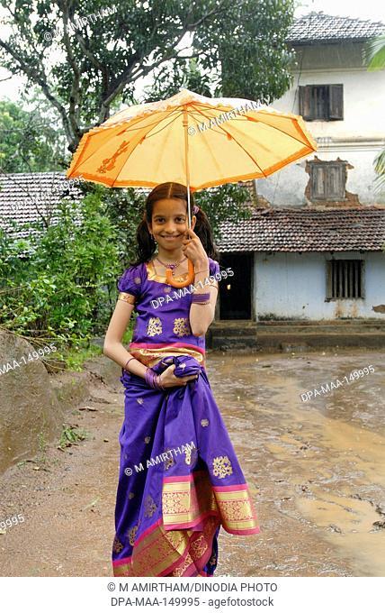 Namboothiri girl holding umbrella ; Panjal ; Kerala ; India NO MR