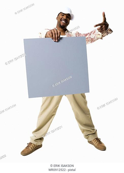 African American man holding a blank sign